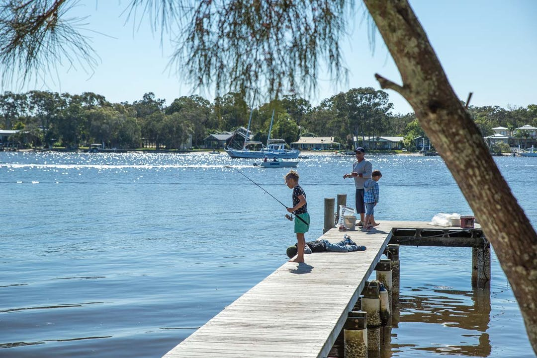 People fishing in Noosa River